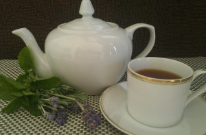 Photo of Teapot and Cup of Black Tea